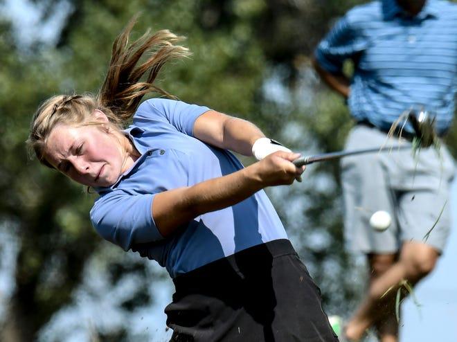 Garden City High School's Ryann Warren hits a fairway shot out of the light rough in September on Buffalo Dunes golf course's No. 10 during the GCHS girls golf invitational.