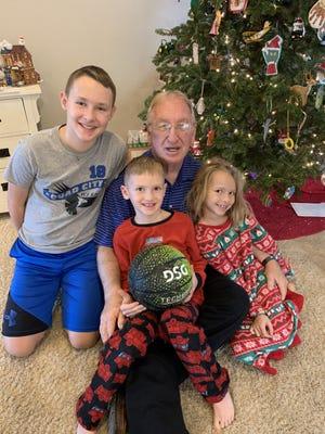 """Coach"" Gary Harlacher surrounded by his grandchildren, Left to right: Hayden Schaaf, Connor Schaaf and Reese Schaaf"