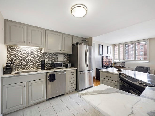 """Truly the """"hub"""" of the floor plan, the kitchen is instantly noteworthy because of its size, as in big. Two people can work comfortably and effectively in this attractive space."""