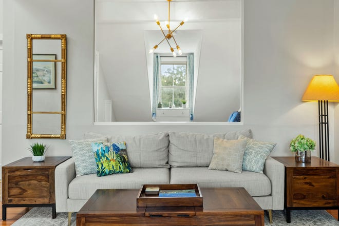 This unit has a bright 20-foot living and dining space with a unique feature: a lovely interior window that looks into the bedroom.