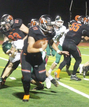 La Junta High School quarterback Luke Garner runs for a big gain on the first play of the game against Manitou Springs on Oct. 8. The Tigers will host Bayfield on Oct. 16.