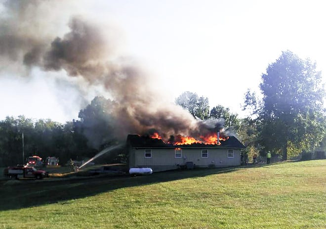 Firefighters respond to a house fire Monday on Turner Road.