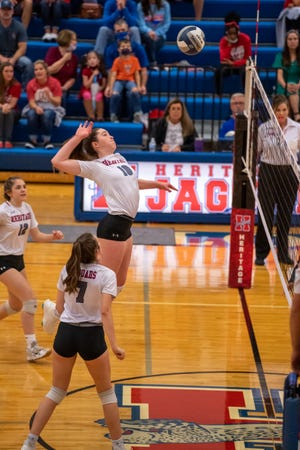 Heritage sophomore Grace Sweeney (10) goes on the attack during a recent home match against Hillsboro as teammates Kensey Clifton (12) and Allie Schmidt (7) look on. The Jaguars avenged a road loss to Class 5A No. 14 Godley with a thrilling 5-set victory on Friday.