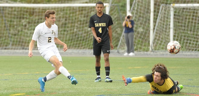 Dustin Simmons shoots past CSM's Richard Miller, giving the Catamounts a 2-1 lead early in the second half.