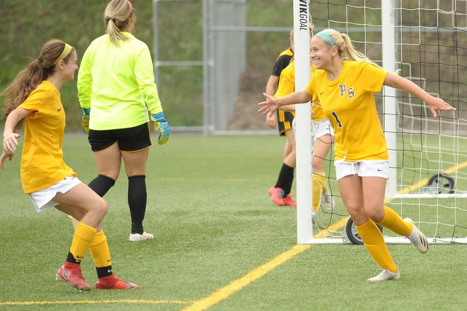 Reagan Miller (left) celebrates with teammate Reagan McKenzie after scoring the winning goal as WVU Potomac State College defeated College of Southern Maryland.