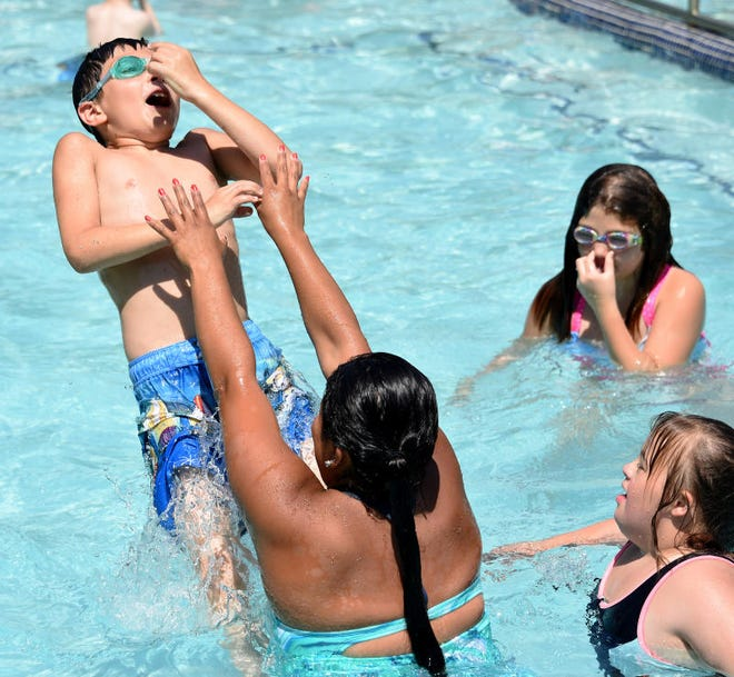In this 2018 photo, children play in a swimming pool at Holiday Camp on N. Custer Rd. in Raisinville Township. The camp will receive $150,000 grant.