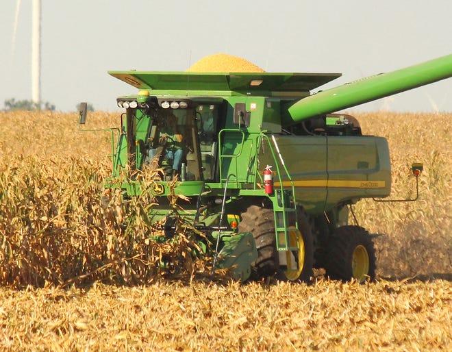 A farmer harvests corn near the Livingston-McLean County line earlier this harvest season.