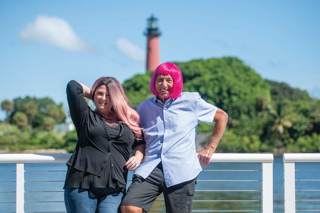 Liz Soulen, director of operations at Charlie and  Joe's at Love Street and  Joe Namath put on pink wigs for the month of October in support of breast cancer awareness and the Susan G. Komen's BigWig campaign.