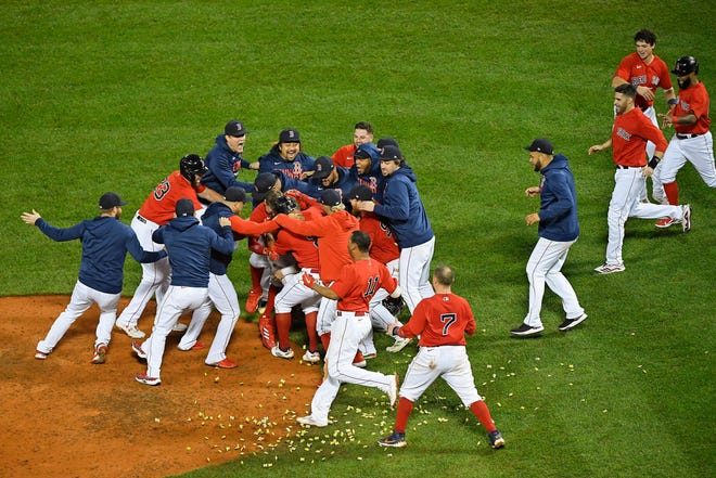 The Boston Red Sox celebrate their win over the Tampa Bay Rays in Game 4 of the 2021 ALDS at Fenway Park on Monday night.