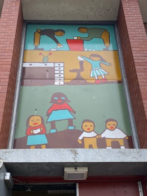 The largest of the four murals painted over recently at Robert F. Kennedy Elementary School in Providence.