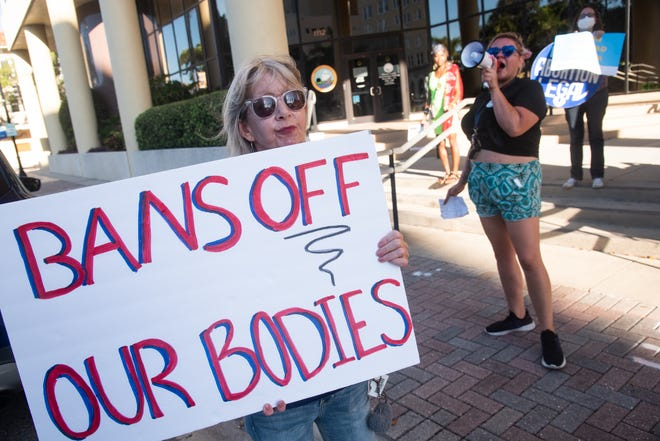 More than a dozen pro-choice advocates rallied outside of the Manatee County administration building in opposition to an effort to implement local abortion restrictions.