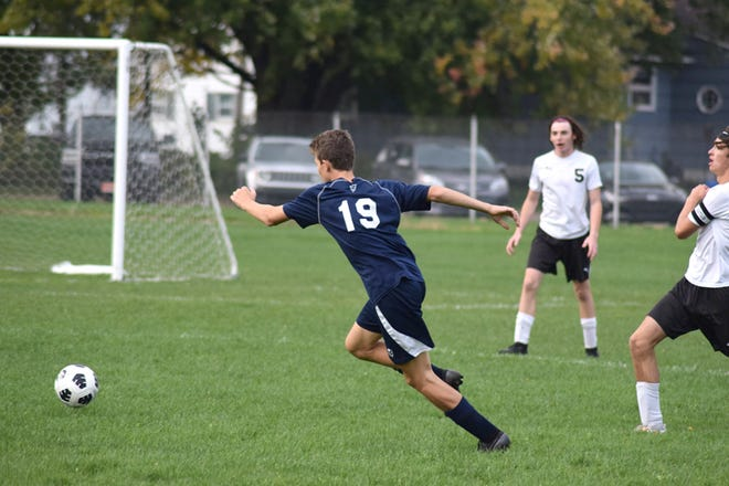 Sault High's Carter Oshelski (19) goes after the ball during the final home soccer game against Cheboygan Monday. The Blue Devils won 6-4.
