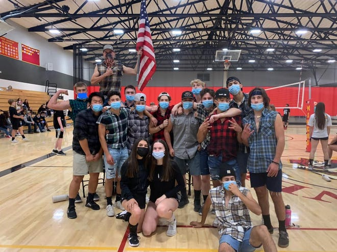 The Yreka High School senior team celebrate after defeating the staff in the Homecoming week Volleybuff game on Monday, Oct. 11, 2021.