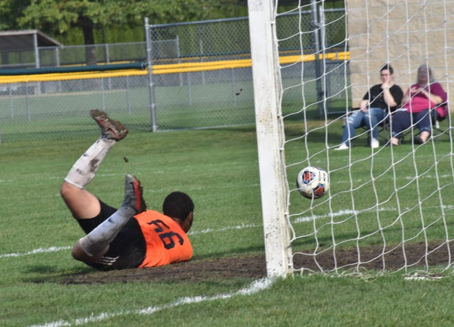 Kewanee's keeper Mikah Israel dives for a save during a regional game with Alleman on Saturday, Oct. 10, in Moline.