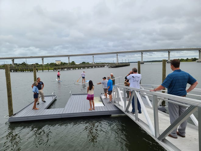 Surf City officials and community members celebrate the opening of a ADA Kayak, Canoe, and Paddleboard Dock. It's one of several recreation ideas in the area. The town is working on future development of the Earl G. & Inez Batts Recreation Complex with help from a land donation.