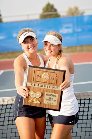 Grace Unruh, left, and Lauren Sweeney show their plaque after capturing their second doubles  regional title in a row.