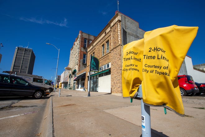 Yellow bags cover parking meters along S.E. 8th street in downtown Topeka. The bags will soon come off as metered parking will resume on Kansas Avenue side streets.