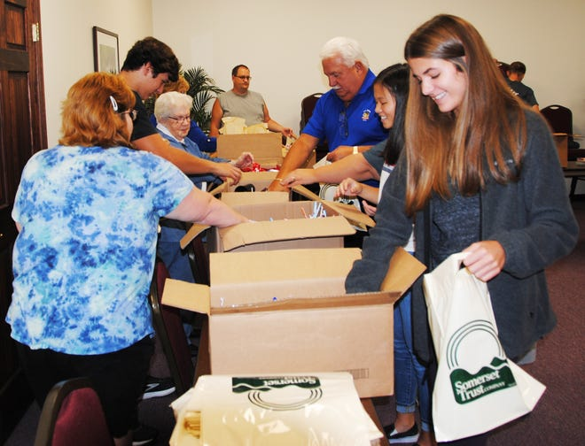 Members of the Kiwanis Club of Somerset, family and friends, and the Somerset Area High School students of the month packed treat bags for the Kiwanis Club Halloween Parade on Oct. 28.