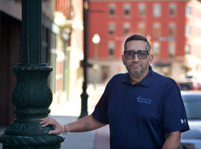 Michael Earielo, program director of Everyday Miracles Peer Recovery Center, Tuesday outside the center on Pleasant Street.