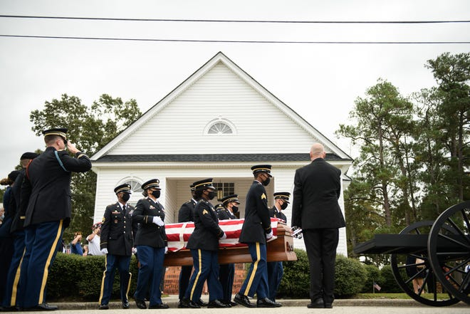 Honor guard soldiers carry 1st Lt. James E. Wright's casket out of Lumber Bridge Baptist Church on Tuesday, Oct. 12, 2021. Wright was killed in action during World War II and his remains were identified on July 9, 2021.