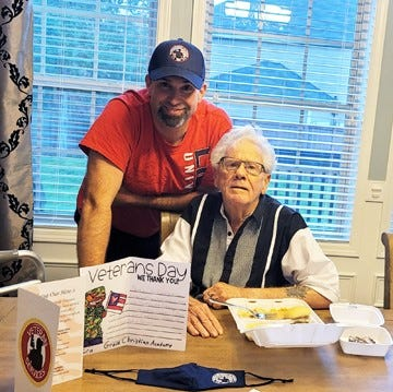 Pictured are a father and son, both veterans, who received a meal last year at the Veterans Night of Honor.