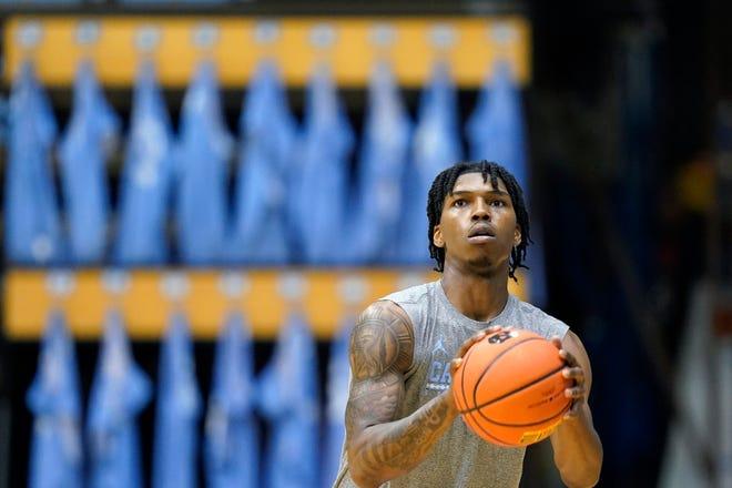 North Carolina guard Caleb Love shoots during preseason basketball practice in late September at the Smith Center.
