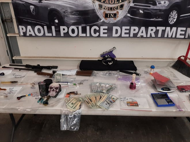 The Paoli Police Department displays items confiscated during a saturation detail that included the execution of a search warrant and a separate traffic stop.