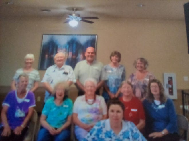 The formers workers of Childcraft/Smith Cabinet met for a reunion. Pictured are: first row, Myra Tippy; second row, left to right, Pat Caves, Jane Mullins, Maxine Sales, Glenda Moore and Juanita Busick; and third row, Lila Drake, Charlie Mullins, Alan Smith, Sharon K. Bowling and Bonnie Trinkle.