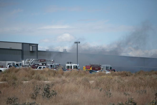 Fire crews battle a blaze at the Vossloh North America plant south of Pueblo on Tuesday October 12, 2021.
