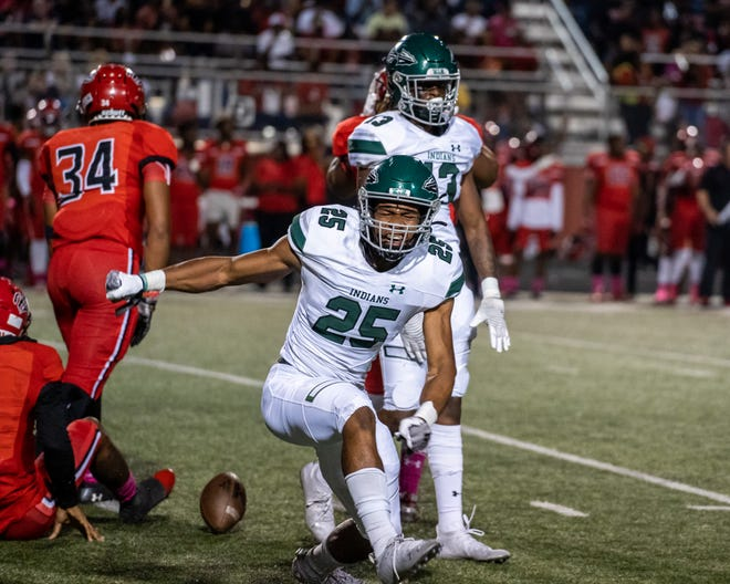 Waxahachie senior defensive end Brendan White (25) celebrates a big play during Friday night's District 11-6A game at Cedar Hill. The Longhorns scored the go-ahead touchdown with just 1:15 left to edge the Indians, 14-10.