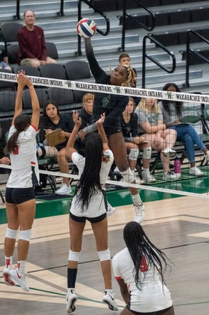 Waxahachie senior Jh'Kyah Head (4) goes up high for a kill during a recent home volleyball match at Mike Turner Gymnasium. The Lady Indians swept Cedar Hill on Friday night.