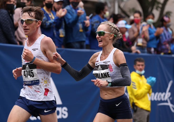 Marblehead native Shalane Flanagan is shown crossing the finish line during the 2021 Boston Marathon on Monday, Oct. 11.