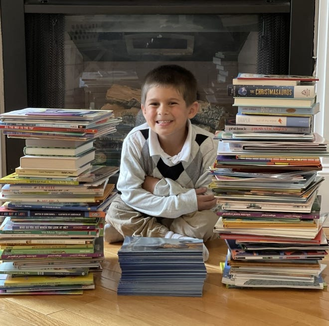 Noah Holt, Amesbury first grader with a rare spinal disorder, has lead a book drive to raise awareness for kids with physical challenges.