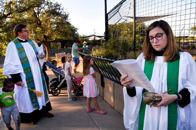 Rev. Corrie Cabes, assistant rector at Episcopal Church of the Heavenly Rest, participates in the Blessing of the Animals at the Abilene Zoo on Oct. 6.