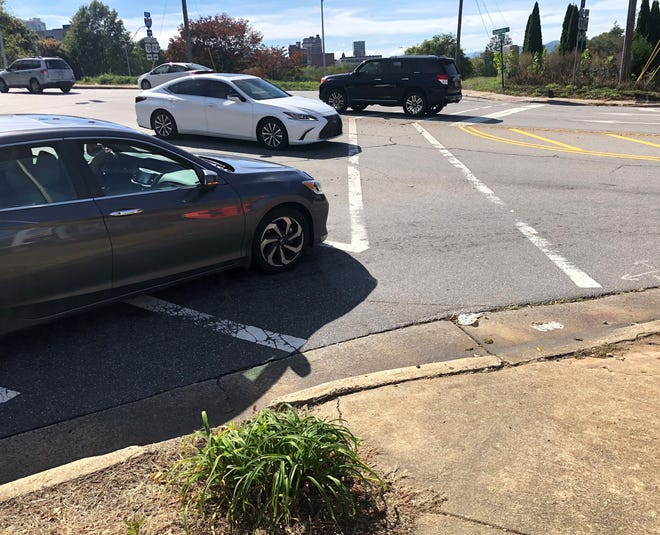 The N.C. Department of Transportation is working on a project to add pedestrian signalization at the intersection of Charlotte Street and I-240 during the 2022 construction season. A reader says it's very difficult for her grandson to navigate the crosswalks and the heavy car traffic in his wheelchair.