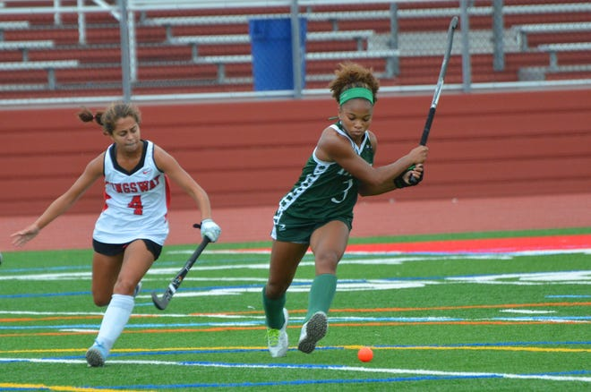 Kingsway defender Allie Patel reaches in as Camden Catholic junior Olivia Bent-Cole winds up to pass through the midfield