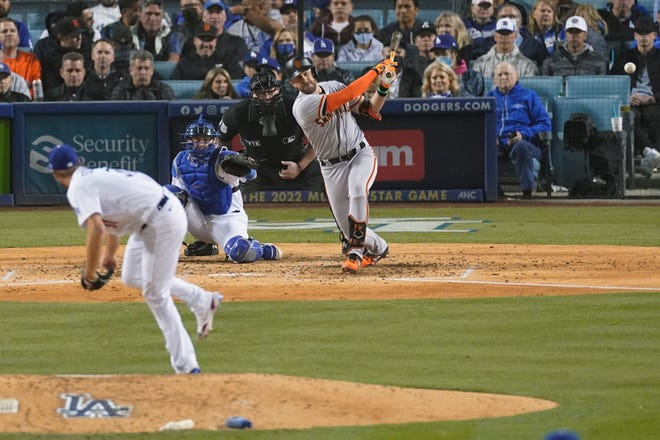 San Francisco Giants' Evan Longoria hits a solo home run off of Los Angeles Dodgers starting pitcher Max Scherzer, left, as catcher Will Smith looks on during the fifth inning of Game 3 of a baseball National League Division Series, Monday, Oct. 11, 2021, in Los Angeles. (AP Photo/Marcio Sanchez)