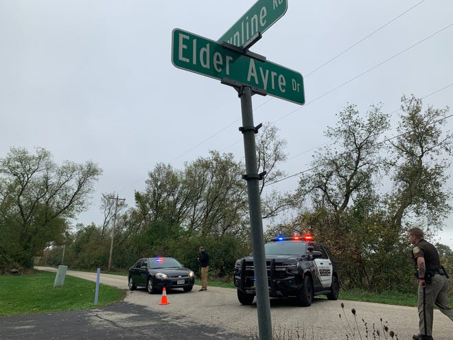 The Waukesha County Sheriff's Department blocks access to the area where a small plane went down in the village of Waukesha on Oct. 12.