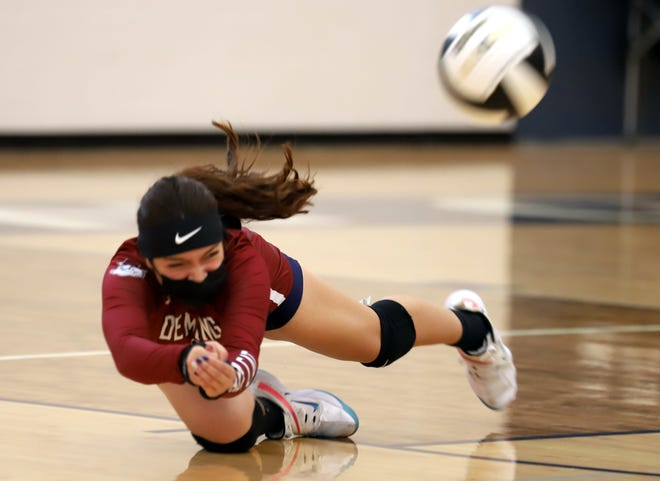 Senior Lady 'Cat Rose Solis goes all-out for the dig and kept Deming High on the attack during Saturday's 25-20, 25-12 and 25-23 home match win over Cobre High School.