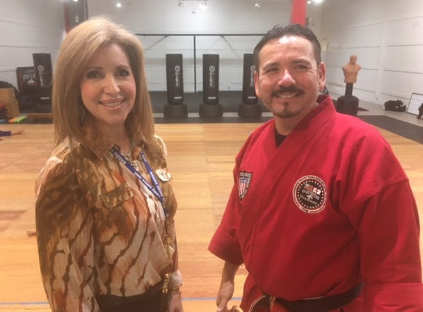 Eli Guzman, owner of Guzman Martial Arts, looks over his new dojo with Mesilla Valley Mall General Manager Loretta Pina.