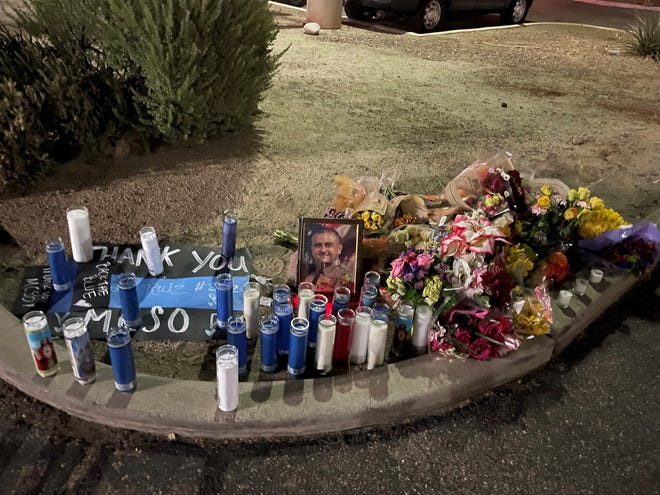 Items honoring Maricopa County Deputy Juan Miguel Ruiz remain after a vigil for him at a substation in Avondale dispersed when shots were fired nearby on Oct. 11, 2021.