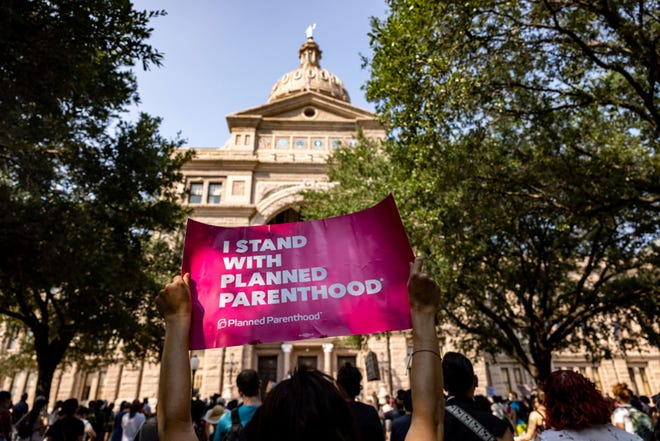 An abortion rights activist holds a sign in support of Planned Parenthood at a rally at the Texas State Capitol on Sept. 11, 2021 in Austin, Texas. (Jordan Vonderhaar/Getty Images/TNS)