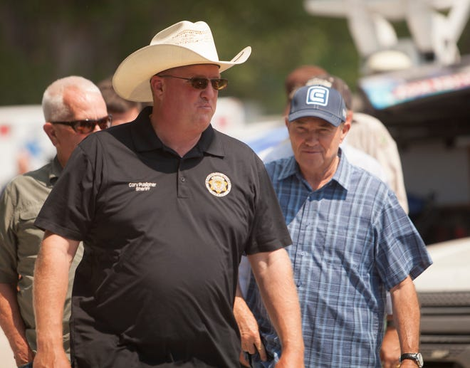 Utah Gov. Gary Herbert, Washington County Sheriff Cory Pulsipher and other area authorities visit Pine Valley to address the saddle fire near the area Wednesday, June 22, 2016.