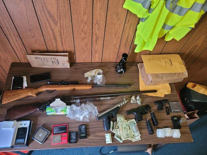 The Wayne County Drug Task Force confiscated cocaine, marijuana, five firearms and $1,300 cash Tuesday, Oct. 12, 2021.