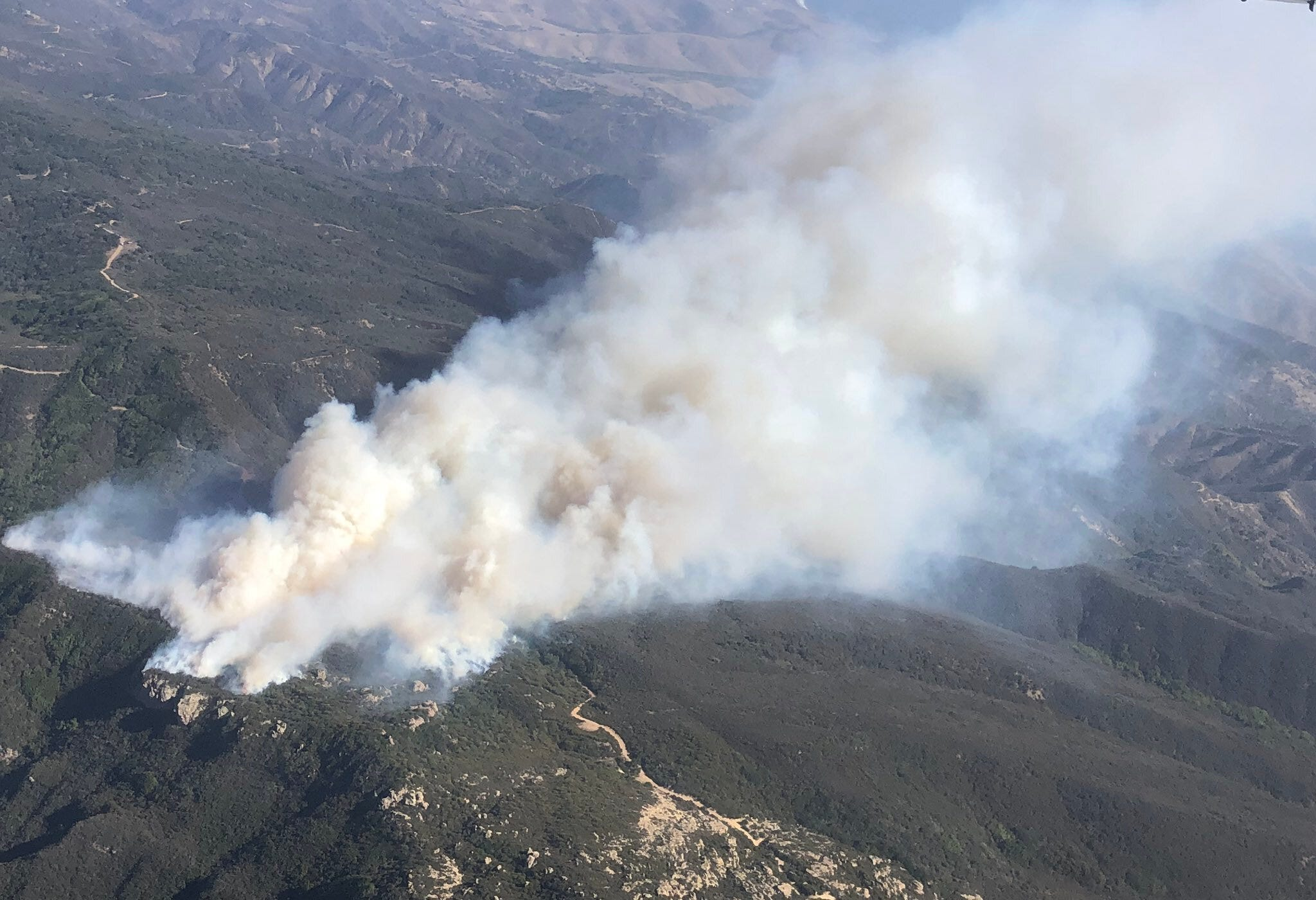 Strong winds fan California wildfires leaving one man burned; Alisal Fire near Santa Barbara burns thousands of acres