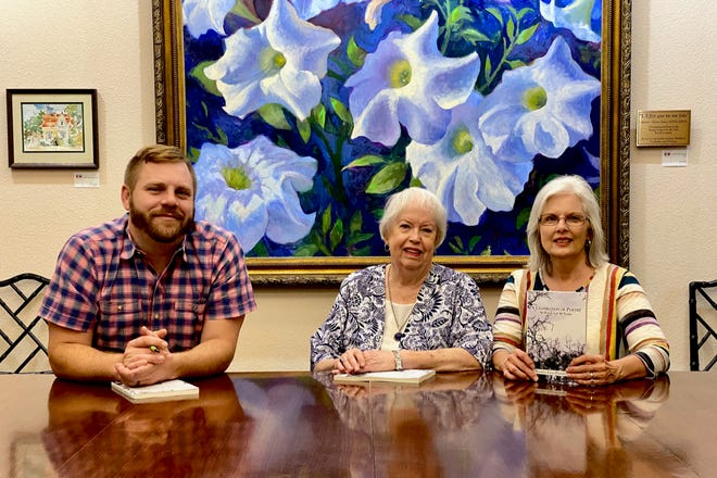 """From left, Nick Schreiber, Linda Smith and Sheri Sutton take a look at the new Wichita Falls Poetry Society book, """"A Celebration of Poetry: 90 Poems for 90 Years."""" The book will have a release event 5:30-8 p.m. Thursday, Oct. 14, at Art on Tap during the 2021 Mystery Art Fest Exhibit in the NorthLight Gallery at the Kemp Center of the Arts."""