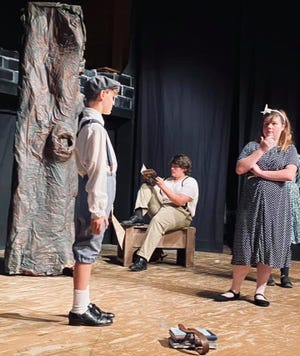 """Ashton Skoutelas, Chad Duek and Catherine Huber in a scene from """"The Hundred Dresses"""" opening at the Renner Theatre."""