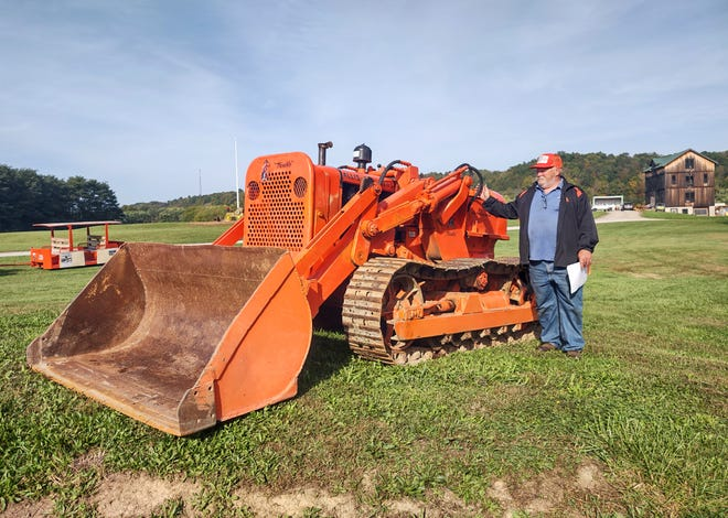 Jeff Moore talks about one of the many pieces of equipment on display for the annual Education of Yesterday show in Dresden.