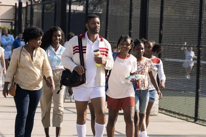 "Aunjanue Ellis, left, Mikayla Bartholomew, Will Smith, Saniyya Sidney, Demi Singleton and Daniele Lawson in tennis drama ""King Richard."""