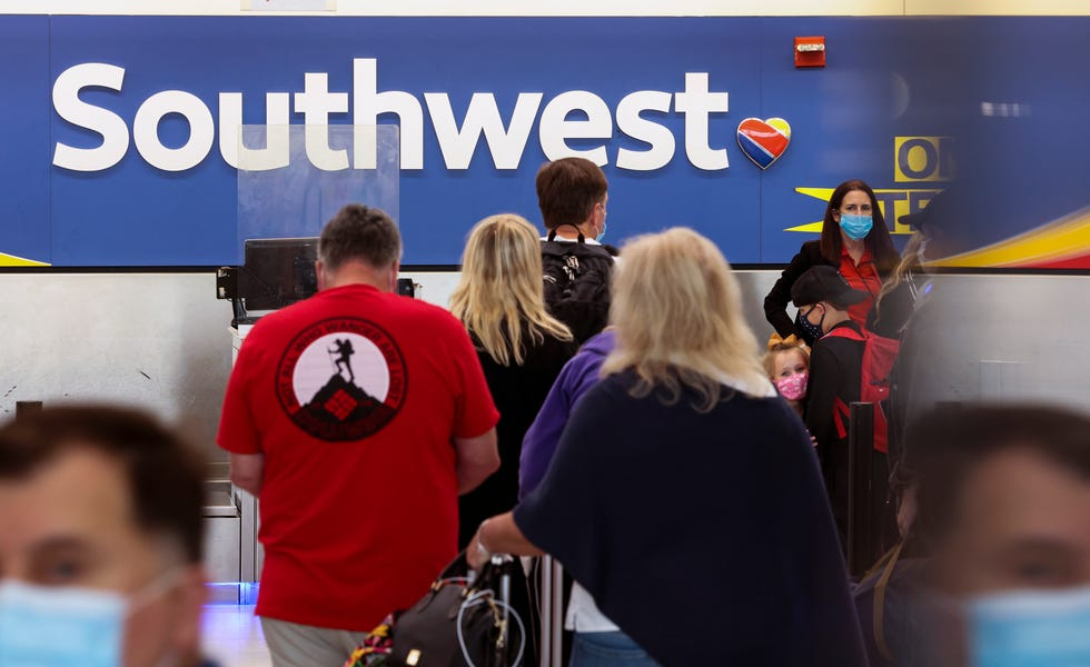 Travelers wait to check-in at the Southwest Airlines ticketing counter at Baltimore Washington International Thurgood Marshall Airport on Oct. 11, 2021.